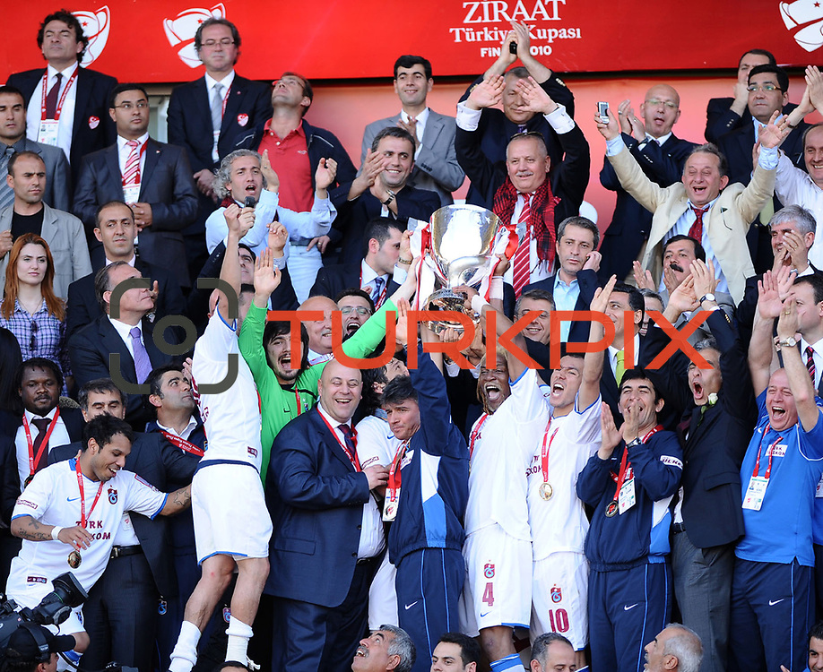 Jubilant Trabzonspor players Alan Carlos Gomes Da COSTA (L), Rigobert Song BAHANAG (2ndR), Umut BULUT (R) lifting up the cup at the ceremony during their after the Turkey Cup final match Trabzonspor between Fenerbahce at the GAP Arena Stadium at Urfa Turkey on wednesday, 05 May 2010. Photo by TURKPIX