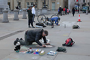 A male street artist draws a portrait outside the National Gallery in Trafalgar Square on the 7th February 2019 in Central London in the United Kingdom. The area outside the National Gallery has become a popular spot for street artists.
