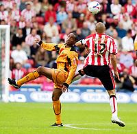 Photo: Daniel Hambury.<br /> Southampton v Wolves. Coca Cola Championship.<br /> 06/08/2005.<br /> Southampton's Nigel Quashie and Wolves' Paul Ince battle for the ball.