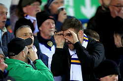 Leeds United fans in the stands make binocular gestures during the Sky Bet Championship match at Elland Road, Leeds.