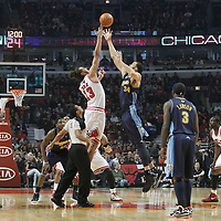 26 March 2012: Jumpball between Chicago Bulls center Joakim Noah (13) and Denver Nuggets center JaValee McGee (34) during the Denver Nuggets 108-91 victory over the Chicago Bulls at the United Center, Chicago, Illinois, USA. NOTE TO USER: User expressly acknowledges and agrees that, by downloading and or using this photograph, User is consenting to the terms and conditions of the Getty Images License Agreement. Mandatory Credit: 2012 NBAE (Photo by Chris Elise/NBAE via Getty Images)