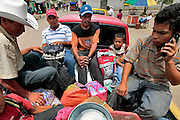 Villagers load onto the back of a pickup truck to hitch a ride back to their small village by the only resident who has a car, after shopping at the market in Guaimaca, Honduras.  Honduras is considered the third poorest country in the Western Hemisphere (Haiti, Nicaragua). With over 50% of the population living below the poverty line and 28% unemployed, Hondurans frequently turn to illegal immigration as a solution to their desperate situation. The Department of Homeland Security has noted an 95% increase in illegal immigrants coming from Honduras between 2000 and 2009, the largest increase of any country.