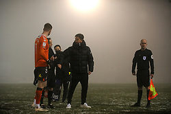 Oldham Athletic manager Harry Kewell bumps fists with Referee Robert Lewis after the game is postponed due to bad weather - Mandatory by-line: Nizaam Jones/JMP - 02/01/2021 - FOOTBALL - innocent New Lawn Stadium - Nailsworth, England - Forest Green Rovers v Oldham Athletic - Sky Bet League Two