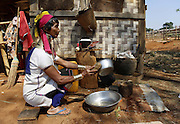 DEMOSO, April 11, 2016 (Xinhua) -- <br /> <br /> A Padaung woman with brass rings around her neck washes plates in Panpet village, Demoso township, Kayah state, Myanmar, April 11, 2016. The brass rings are first applied when the Padaung girls are about eight years old and as the girl grows older, longer coils are added up to 24 or 25 rings.<br /> ©Exclusivepix Media