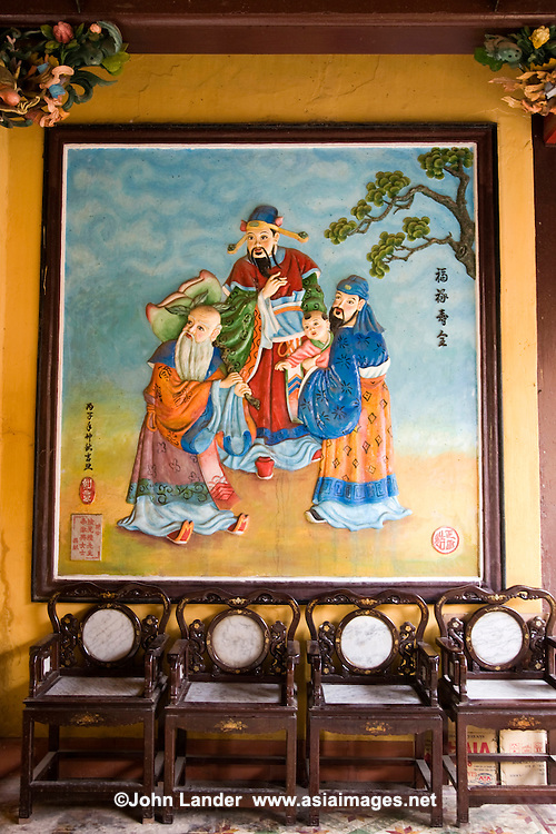 Colorful Mural at Trieu Chau Assembly Hall,  built in honor of Fu Lu Shuo, the diety of Wealth, Happiness and Longetivity. Worshippers come here to make oaths or ask favors.