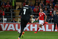 Gareth Bale of Wales chases the ball. Wales v Moldova , FIFA World Cup qualifier at the Cardiff city Stadium in Cardiff on Monday 5th Sept 2016. pic by Andrew Orchard, Andrew Orchard sports photography