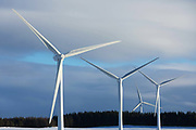 Wind turbines harnessing the wind in the Scottish Borders on 25th of January 2021 in Scotland, United Kingdom. The wind farm, Longpark Wind Farm, is long established and part of the renewable energy production in Scotland. The farm sits in the hills above the village Stow, near Galashields in the Scottish Borders.