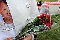 """Maria Alcantar, mother of Azahel Cruz, holds roses for him during Sunday's """"100 Mothers Vigil."""" in Salinas. The 6-year-old was struck in the head and killed by a stray bullet during a nearby gang shootout on March 23rd, 2010."""