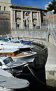 Boats moored near Zadar's Town Land Gate (Kopnena Vrata), colloquially Lavlja Vrata (the Lion's Gate). Zadar, Croatia
