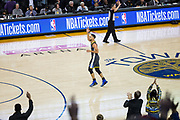 Golden State Warriors guard Stephen Curry (30) celebrates a basket against the LA Clippers at Oracle Arena in Oakland, California, on February 22, 2018. (Stan Olszewski/Special to S.F. Examiner)