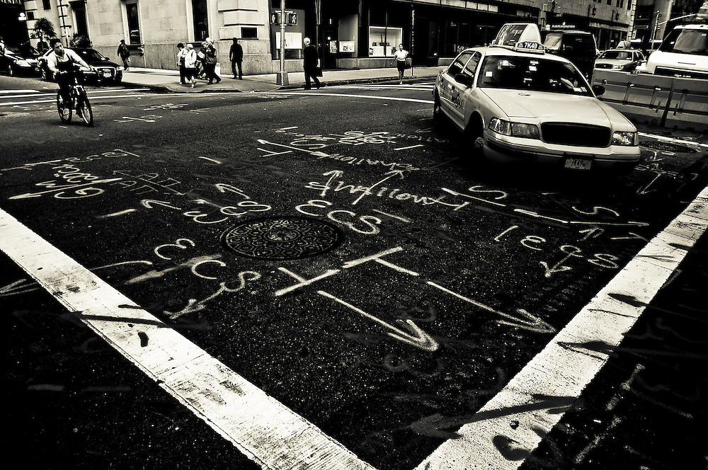 Signs painted on the streets of Manhattan before public works, New York, 2009.