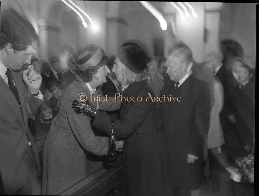 Removal of the Remains of Mr.George Colley..1983.19.09.1983.09.19.1983.19 September 1983..Picture as Mr and Mrs Liam Cosgrave offer condolences to Mrs Colley and son Eoin. The funeral mass was held in the Church of Three Patrons,Rathgar,Dublin.