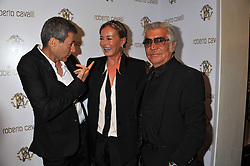 Left to right, URI GELLER and ROBERTO & EVA CAVALLI  at a party hosted by Roberto Cavalli to celebrate his new Boutique's opening at 22 Sloane Street, London followed by a party at Battersea Power Station, London SW8 on 17th September 2011.