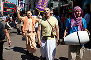 Followers of Hare Krishna promoting their faith on Oxford Street in London, UK. The Hare Krishna mantra, also referred to reverentially as the Maha Mantra, is a sixteen-word Vaishnava mantra which first appeared in the Kali-Santarana Upanishad, and which from the 15th century rose to importance in the Bhakti movement following the teachings of Chaitanya Mahaprabhu.