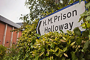 The road sign directing people to HMP Holloway, the main womens prison in London. HM Prison Holloway (sometimes known as Holloway Castle) is a closed category prison for adult women and Young Offenders, located in the Holloway area of the London Borough of Islington, in north and Inner London, England. The prison is operated by Her Majesty's Prison Service. Holloway Prison holds female adults and young offenders remanded or sentenced by the local courts. Holloway prison offers both full-time and part-time education to inmates, with courses including skills training workshops, British Industrial Cleaning Science BICS, gardens and painting. There is a family-friendly visitor centre at Holloway, run by the Prison Advice & Care Trust (pact), an independent charity.