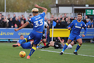 AFC Wimbledon striker Lyle Taylor (33) with shot on goal during the EFL Sky Bet League 1 match between AFC Wimbledon and Peterborough United at the Cherry Red Records Stadium, Kingston, England on 12 November 2017. Photo by Matthew Redman.