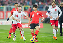 March 27, 2018 - Chorzow, Poland - Kamil Grosicki and Maciej Rybus of Poland vie Chang-hoon Kwon (KOR)   during the international friendly soccer match between Poland and South Korea national football teams, at the Silesian Stadium in Chorzow, Poland on 27 March 2018. (Credit Image: © Foto Olimpik/NurPhoto via ZUMA Press)