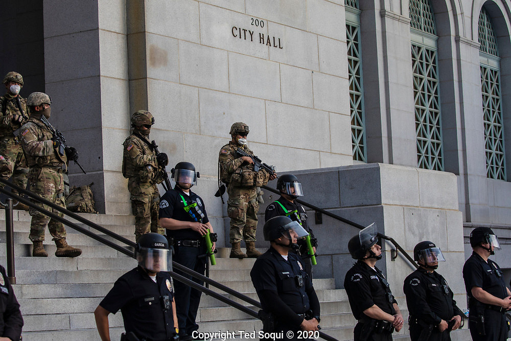 California National Guard deploy around Los Angeles City Hall. A small demonstration upset about the killing of George Floyd gathered on the west steps of city hall.<br /> 5/31/2020 Los Angeles, CA USA<br /> (Photo by Ted Soqui)