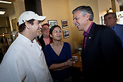 Republican presidential candidate Gov. Jon Huntsman of Utah thanks the owners of the Honeycomb Cafe on Daniel Island following a campaign event January 12, 2012 in Charleston, South Carolina.