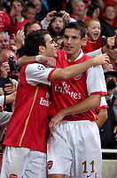 Photo: Ed Godden/Sportsbeat Images.<br /> Arsenal v Sevilla. UEFA Champions League Group H. 19/09/2007. Arsenal's Cesc Fabregas (L), celebrates his goal.