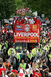 LIVERPOOL, ENGLAND - THURSDAY, MAY 26th, 2005: Liverpool fans cheer as the players (L-R: Jamie Carragher, Luis Garcia, Jerzy Dudek, Dietmar Hamann and John Arne Riise) parade the European Champions Cup on on open-top bus tour of Liverpool in front of 500,000 fans after beating AC Milan in the UEFA Champions League Final at the Ataturk Olympic Stadium, Istanbul. (Pic by David Rawcliffe/Propaganda)