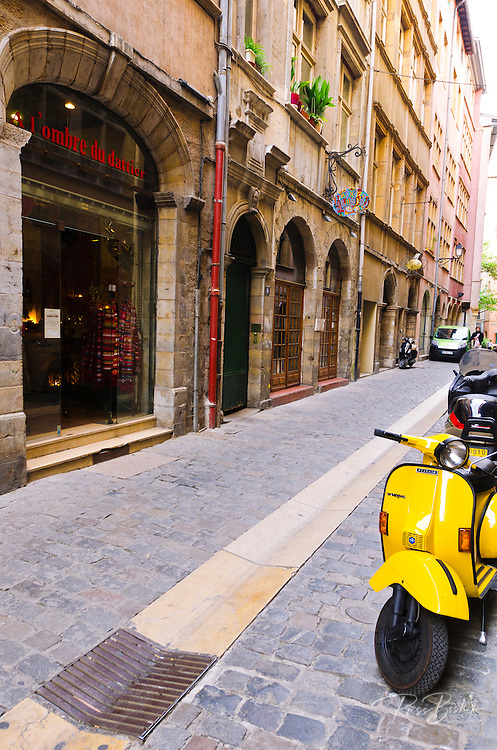Cobblestone street and scooter in old town Vieux Lyon, France (UNESCO World Heritage Site)