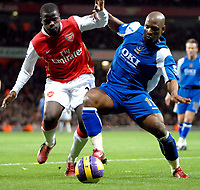 Photo: Ed Godden.<br /> Arsenal v Portsmouth. The Barclays Premiership. 16/12/2006. Arsenal's Emmanuel Eboue (L), tackles Noe Pamarot.