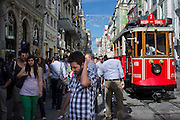 Istiklal Street, one of the most famous avenues in Istanbul, Turkey, visited by nearly 3 million people in a single day over the course of weekends. Located in the historic Beyoglu district, it is roughly three kilometres long, housing boutiques, bookstores, art galleries, theatres, libraries, cafés and restaurants..The avenue, surrounded by late Ottoman era buildings starts from the medieval Genoese neighbourhood around Galata Tower and ultimately leads up to Taksim Square..Istanbul 7 June 2012