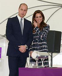The Duke and Duchess of Cambridge with a time capsule at a tour of the University of Manchester to view the National Graphene Institute during a day of engagements in Manchester.
