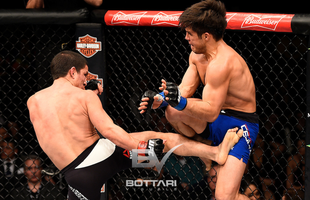 LAS VEGAS, NV - DECEMBER 03:  (L-R) Joseph Benavidez kicks Henry Cejudo in their flyweight bout during The Ultimate Fighter Finale event inside the Pearl concert theater at the Palms Resort & Casino on December 3, 2016 in Las Vegas, Nevada. (Photo by Jeff Bottari/Zuffa LLC/Zuffa LLC via Getty Images)