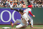 San Francisco Giants first baseman Ryder Jones (63) slides into second base against the Philadelphia Phillies at AT&T Park in San Francisco, California, on August 20, 2017. (Stan Olszewski/Special to S.F. Examiner)