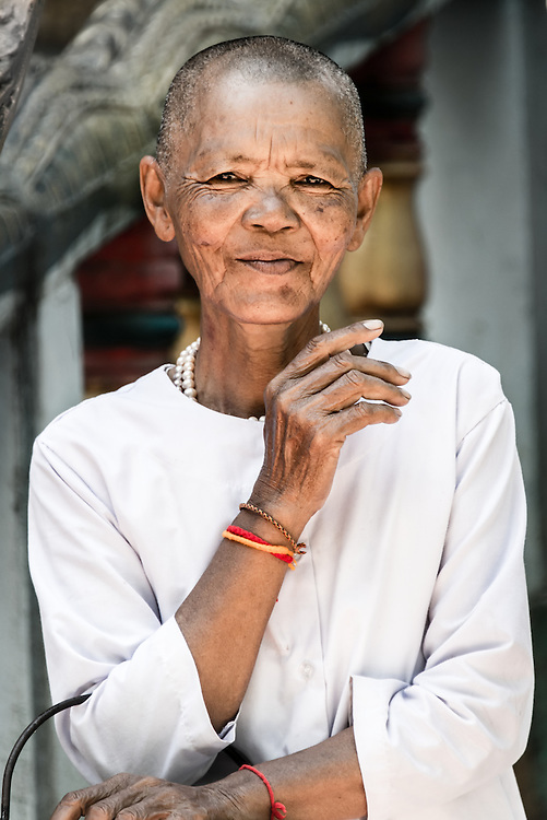 A Buddhist nun looking directly at the camera. The image was captured at Peung Pagoda in Cambodia.
