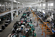 Workers assemble strollers at a Goodbaby factory in Kunshan, Jiangsu Province, China, on Monday, May 04, 2009. Goodbaby is China's largest manufacturer and supplier of infants' and children's products.