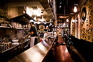 Chefs working in death chili noodle bar in Tokyo, Japan.