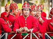 "14 JANUARY 2015 - BANGKOK, THAILAND:  Men who portray oarsman for the Royal Barges wait for the 2015 Discover Thainess parade to start. The Tourism Authority of Thailand (TAT) sponsored the opening ceremony of the ""2015 Discover Thainess"" Campaign with a 3.5-kilometre parade through central Bangkok. The parade featured cultural shows from several parts of Thailand. Part of the ""2015 Discover Thainess"" campaign is a showcase of Thailand's culture and natural heritage and is divided into five categories that match the major regions of Thailand – Central Region, North, Northeast, East and South.    PHOTO BY JACK KURTZ"