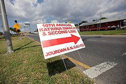 29 August 2015. Lower 9th Ward, New Orleans, Louisiana.<br /> Hurricane Katrina 10th Anniversary.<br /> A sign points to the 10th annual Katrina March and second on Tennessee Street as residents and mourners celebrate the lives of those lost to the storm. <br /> Photo credit©; Charlie Varley/varleypix.com.
