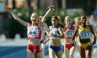 Friidrett - Athletics<br /> Junior-VM 2004 - World Junior Championships 2004<br /> Grosseto - Italia - Italy<br /> 16.07.2004<br /> Foto: Morten Olsen, Digitalsport<br /> <br /> 800 meter kvinner<br /> 66 Natalya Koreyvo - Hviterussland<br /> 597 Mariya Shapaeva - Russland<br /> 391 Kay-Ann Thompson - Jamaica<br /> 536 Simona Barcau - Romania