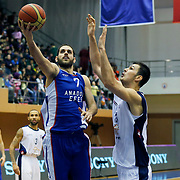 Anadolu Efes's Stratos Perperoglou (L) during their Turkish Basketball League match Istanbul BSB between Anadolu Efes at Cebeci Arena in Istanbul Turkey on Monday 09 March 2015. Photo by Aykut AKICI/TURKPIX