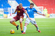 Matthew Kennedy (#33) of St Johnstone FC challenges Liam Grimshaw (#14) of Motherwell FC during the Ladbrokes Scottish Premiership match between St Johnstone and Motherwell at McDiarmid Stadium, Perth, Scotland on 11 May 2019.