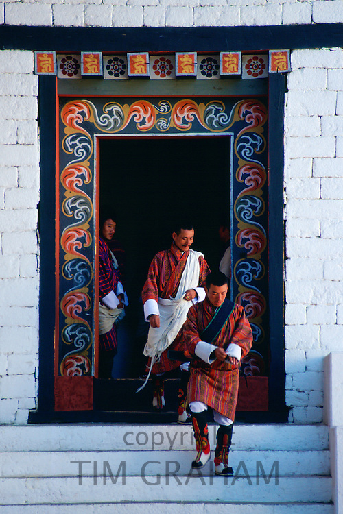 Government officials leave Tashichho Dzong, the Government administration building in Thimpu, Bhutan.
