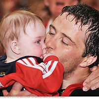24 May 2008; Munster's Marcus Horan kisses his daughter Heather after victory over Toulouse. Heineken Cup Final, Munster v Toulouse, Millennium Stadium, Cardiff, Wales. Picture credit: Brendan Moran / SPORTSFILE