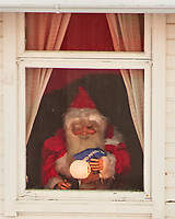 Santa caught hiding in Finnsnes, Norway after Christmas. Image taken with a Nikon D800 camera and 180 mm f/2.8 lens (ISO 100, 180 mm, f/4, 1/100 sec).