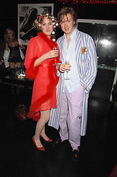 VIOLET NAYLOR-LEYLAND and TOM HOWARD at a pajama party at The Cuckoo Club, Swallow Street, London on 2nd April 2008.<br /><br />NON EXCLUSIVE - WORLD RIGHTS