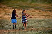 Two girls dancing in a field, Glastonbury Festival 2010