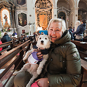VENICE, ITALY - JANUARY 15:  A woman and her dog pose for a picture while attending  a special service with a blessing of  pets and animals held at the Church of S Francesco da Paola on January 15, 2012 in Venice, Italy. The blessing of animals and pets is a very ancient tradition dating back from San Francis of Assisi.