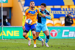 Jordan Bowery of Mansfield Town holds off pressure from Andrew Dallas of Cambridge United - Mandatory by-line: Ryan Crockett/JMP - 20/02/2021 - FOOTBALL - One Call Stadium - Mansfield, England - Mansfield Town v Cambridge United - Sky Bet League Two