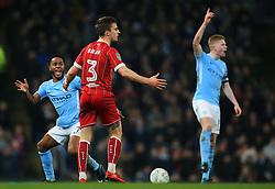 Raheem Sterling of Manchester City reacts towards Joe Bryan of Bristol City - Mandatory by-line: Matt McNulty/JMP - 09/01/2018 - FOOTBALL - Etihad Stadium - Manchester, England - Manchester City v Bristol City - Carabao Cup Semi-Final First Leg