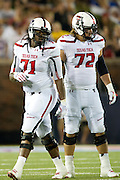 DALLAS, TX - AUGUST 30: Trey Kennan #71 and Beau Carpenter #72 of the Texas Tech Red Raiders looks on against the SMU Mustangs on August 30, 2013 at Gerald J. Ford Stadium in Dallas, Texas.  (Photo by Cooper Neill/Getty Images) *** Local Caption *** Trey Kennan, Beau Carpenter