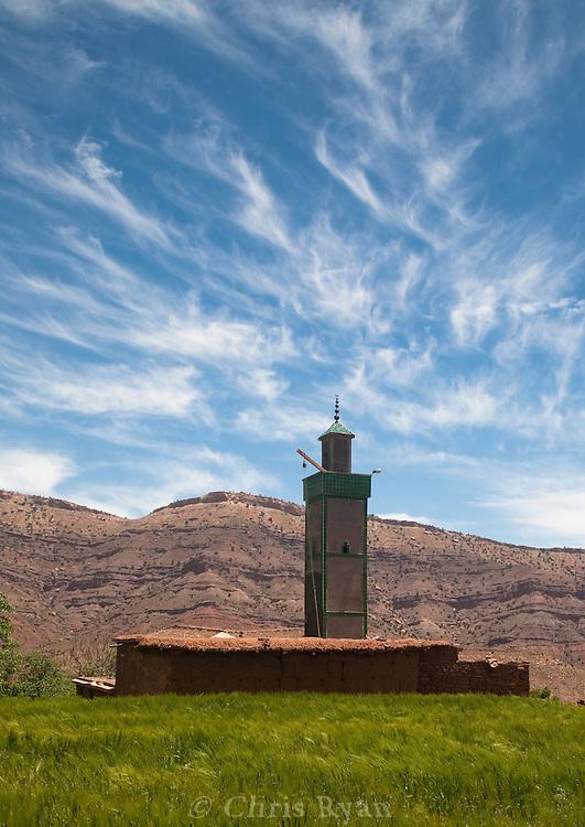 Wispy clouds and minaret, Ighrem N'Ougdal, Ouarzazate, Atlas Mountains, Morocco