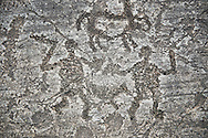 Prehistoric Petroglyph, rock carving, of two men fighting with swords and small shield carved by the Camunni people in the ,iddle to late iron age between  900-1200 BC, Rock no 18, Seradina II area , Seradina-Bedolina Archaeological Park, Valle Comenica, Lombardy, Italy .<br /> <br /> Visit our PREHISTORY PHOTO COLLECTIONS for more   photos  to download or buy as prints https://funkystock.photoshelter.com/gallery-collection/Prehistoric-Neolithic-Sites-Art-Artefacts-Pictures-Photos/C0000tfxw63zrUT4<br /> If you prefer to buy from our ALAMY PHOTO LIBRARY  Collection visit : https://www.alamy.com/portfolio/paul-williams-funkystock/valcamonica-rock-art.html